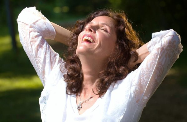woman in bliss outside