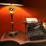 old typewriter and lamp on a desk